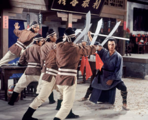 "Kuo fights off a handful of men in ""Crippled Avengers""."